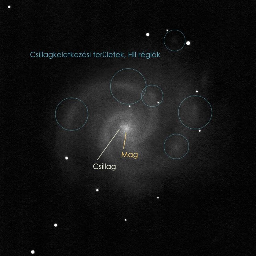 Csillagkeletkezési területek az M74-ben.